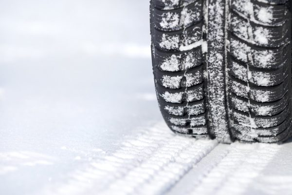 Tire in snow showing when to replace winter tires