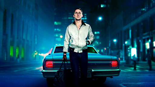 Ryan Gosling leaning up against his car in the movie Drive
